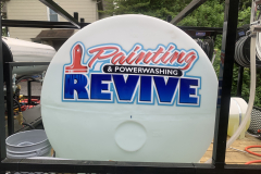 REVIVE_Painting_Power_Wash_Trailer_Lettering
